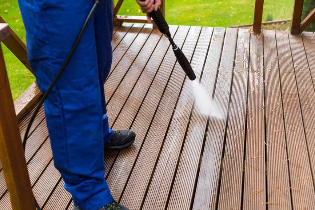 someone cleaning the wood deck